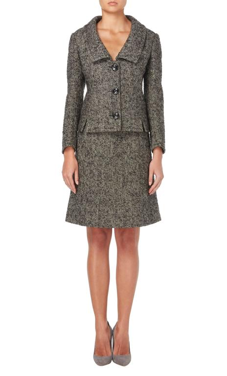 A fantastic way of introducing vintage haute couture into your everyday wardrobe, this Nina Ricci skirt suit is perfect for the office. Designed while Jules Fran̤ois Crahay was head designer at the label, this suit consists of a skirt and jacket