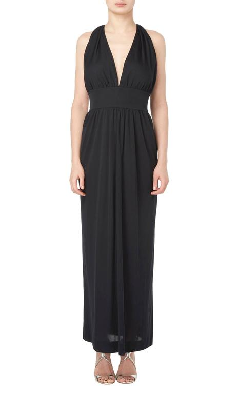 This stunning Pucci maxi dress is the ideal summer dress, constructed in airy black silk artfully gathered over the bust, the dress has a flattering halterneck style back and a wide waistband adding definition to the silhouette. Throw on for hot