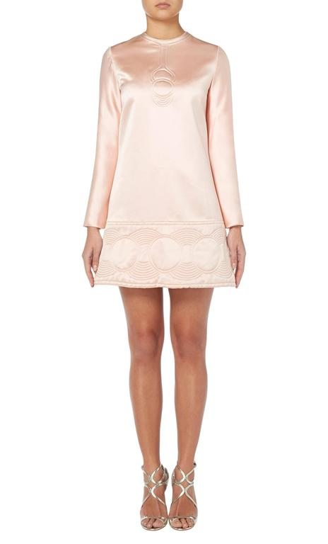 Constructed in pale pink silk Featuring an op art style quilted detail to the bust and hemline Zip fastening to the rear Excellent condition with some slight wear to the right shoulder and bears the original label and lining Professionally dry
