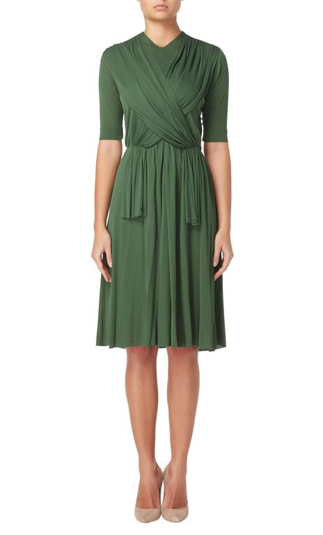 Constructed in green silk jersey Featuring a signature unfinished hemline and sash detail to the front Zip fastening to the rear Excellent condition with the original label Professionally dry cleaned and ozone-treated Inspected by a