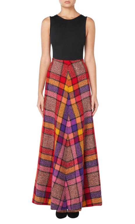 This brightly coloured Missoni maxi skirt is a fabulous example of the design house's early work. Constructed in plaid wool in clashing shaded of pink, yellow, red and purple, the skirt sits on the waist with an A-line silhouette. Perfect for
