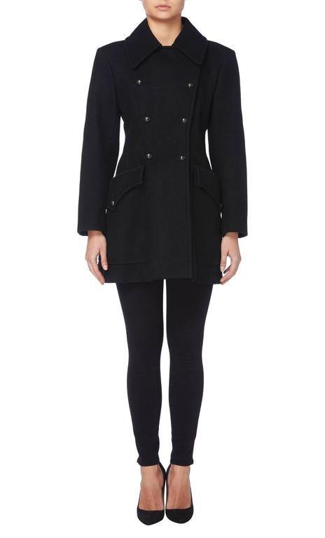 This classic Yves Saint Laurent peacoat is truly timeless and will quickly become a wardrobe staple. Constructed in black wool, the double-breasted coat features a double lapel collar and overscale pockets on the hip. Black buttons fasten to the