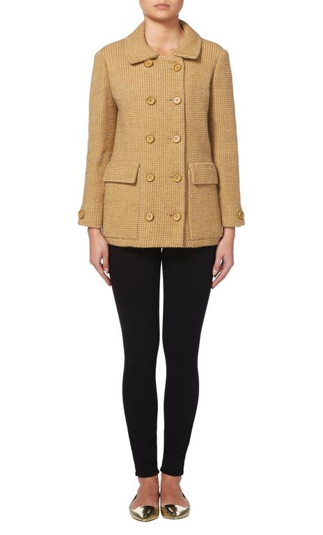This easy to wear jacket by Guy Laroche is constructed from tan and beige tweed wool from the famous French textile company, Rodier. Perfect for everyday, this double-breasted jacket will look great teamed with skinny jeans or tailored trouers and