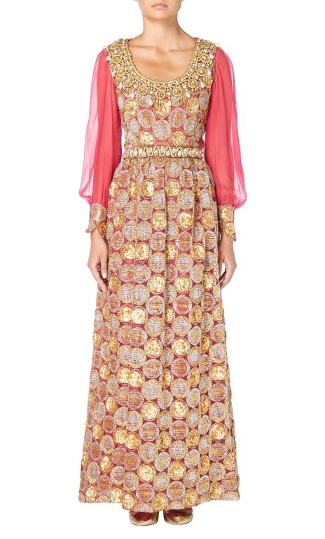 This Oscar de le Renta maxi dress is the perfect choice for a decadent evening look. Constructed in raspberry pink silk chiffon and metallic gold and silver Lurex tulle, the dress has a seductive shimmer. The scooped neckline is heavily embellished