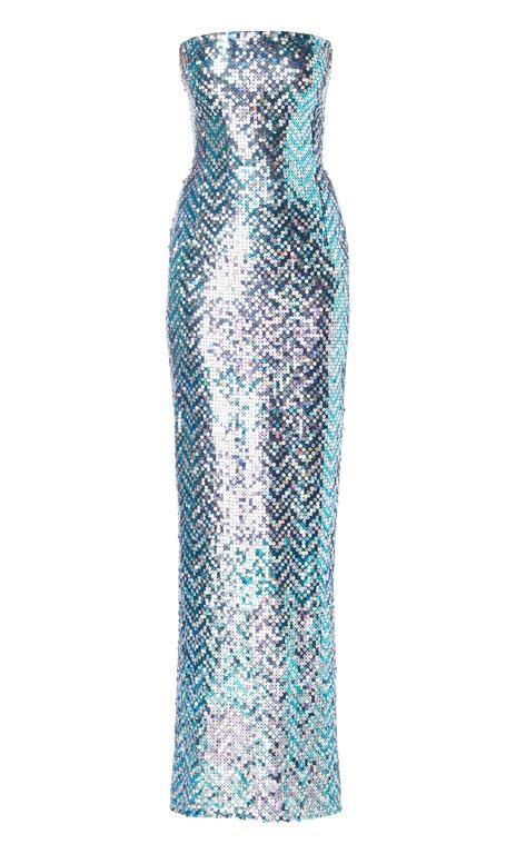 An incredible piece of haute couture, this Pierre Cardin dress is sure to make a statement on the red carpet!  The figure-hugging, strapless dress is entirely covered in iridescent amethyst, blue and silver sequins, and is accompanied by a dramatic