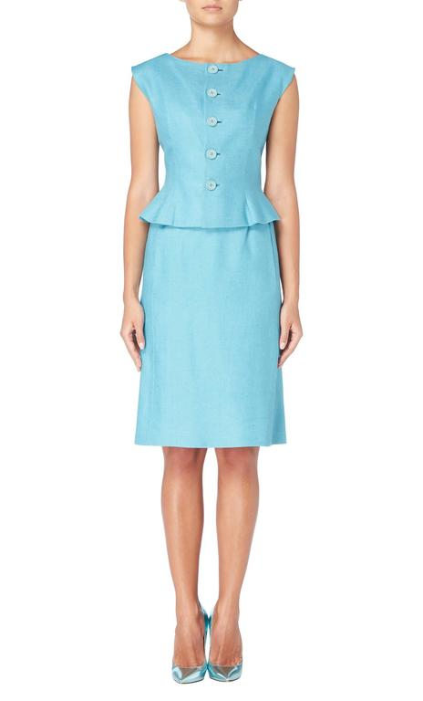 A fantastic piece of summer tailoring, this Norell skirt suit will add a pop of colour to a work wear wardrobe. Constructed in sky blue linen and comprising of a sleeveless top and knee length skirt, the top features buttons to the front, flaring