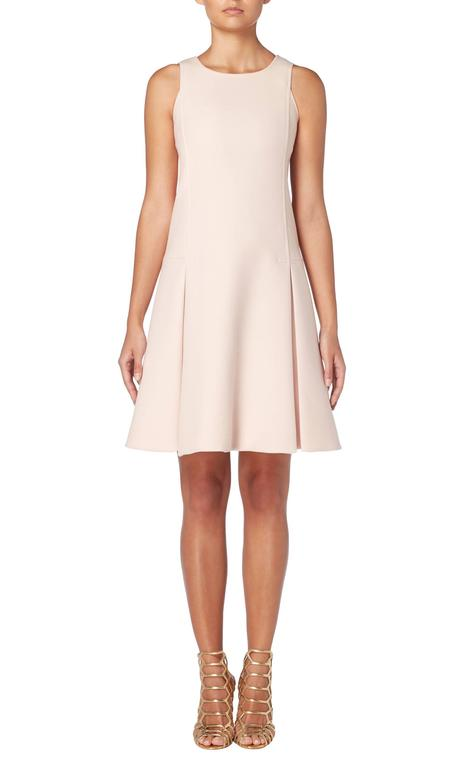 This super chic Courrèges dress is a great way of wearing haute couture every day. Constructed in pale pink wool, the sleeveless dress has a drop waist silhouette and box pleated skirt. Wear with flat sandals for a chic day look or dress up with
