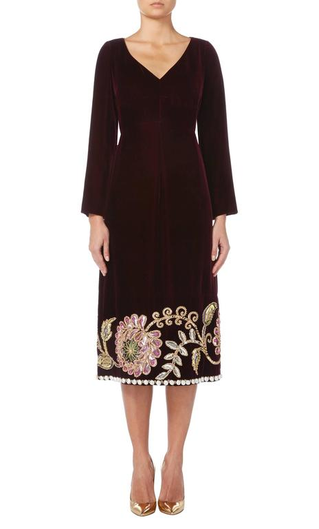 This dress is an amazing example of Marc Bohan for Dior from the Autumn Winter 1969 collection. Constructed in plush purple velvet, the dress features a v-neckline and long sleeves, while the hem is heavily embellished with metallic applique and