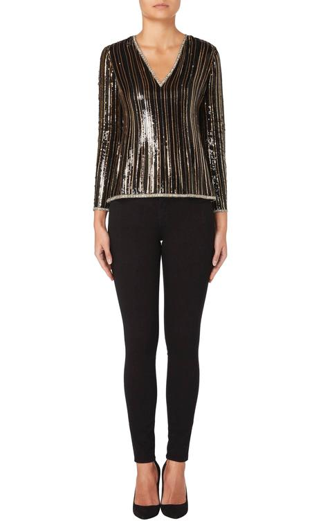 This shimmering Yves Saint Laurent haute couture top is made from black silk chiffon and embellished with scores of black, silver and gold sequins in vertical stripes, while crystal embellishment on the v-neckline, hem and cuffs adds to the