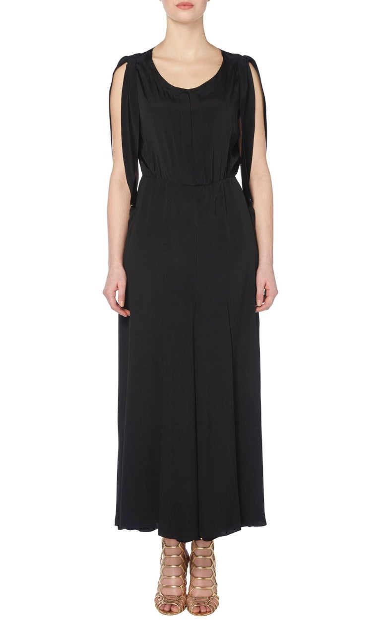 A wonderful and wearable example of haute couture from the 1930s Art Deco period, this flapper dress by Jean Patou is impossibly chic. Constructed in black silk, the dress features technically brilliant detailing by a design legend with an open