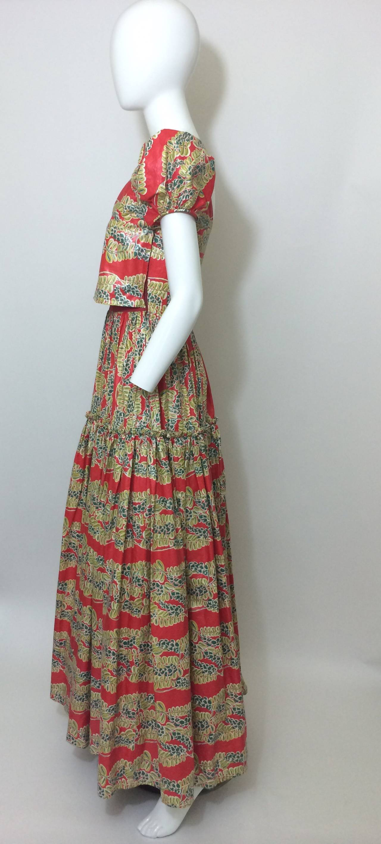 This is a beautiful full length maxi dress from the 1940's. The fabric is a polished cotton which has a soft touch and a beautiful sheen. Featuring a square neckline and dainty pouf sleeves. The front bodice is lined with a stretch jersey fabric