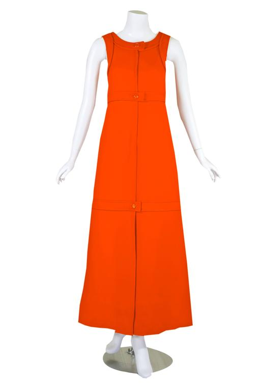 A rare original 1960s Courreges numbered couture bright orange wool sculpted A-line shift dress. This outstanding dress is fashioned from a wool gabardine and features all of  his great couture techniques. The tailoring, structuring and seaming  are