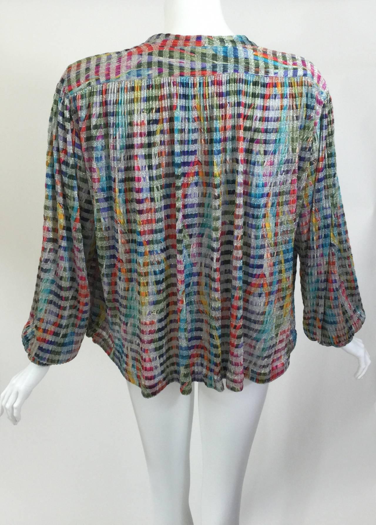 A gorgeous multi - color metallic knit cardigan.