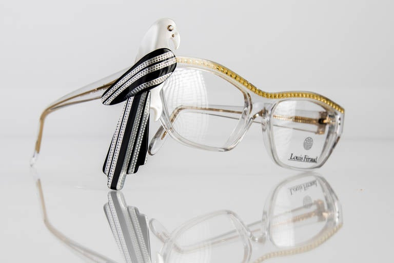 Rare and collectable,  Louis Feraud  French designer frames, made in France in the late 1980s .The frames are clear in a modified cat eye shape and are adorned with yellow rhinestones across the top .The parrot is removable, and can be worn with or