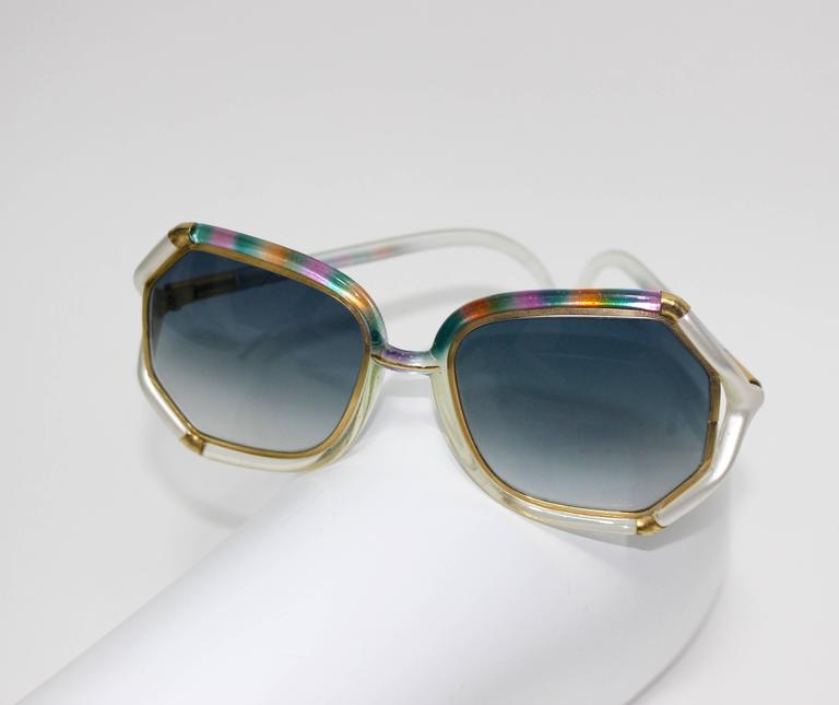 Vintage Ted Lapidus sunglasses with rainbow trim across the top and sides. The lenses are framed in gold with  mother of pearlesque detail.