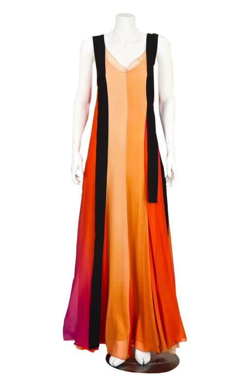 A stunning Sonia Rykiel  gown from spring 2012. Long flowing  color block ombre panels of  fine  silk chiffon in nudes, apricot, vibrant orange and magenta.   Black silk streamer shoulder straps float over the gown and off to the side. This