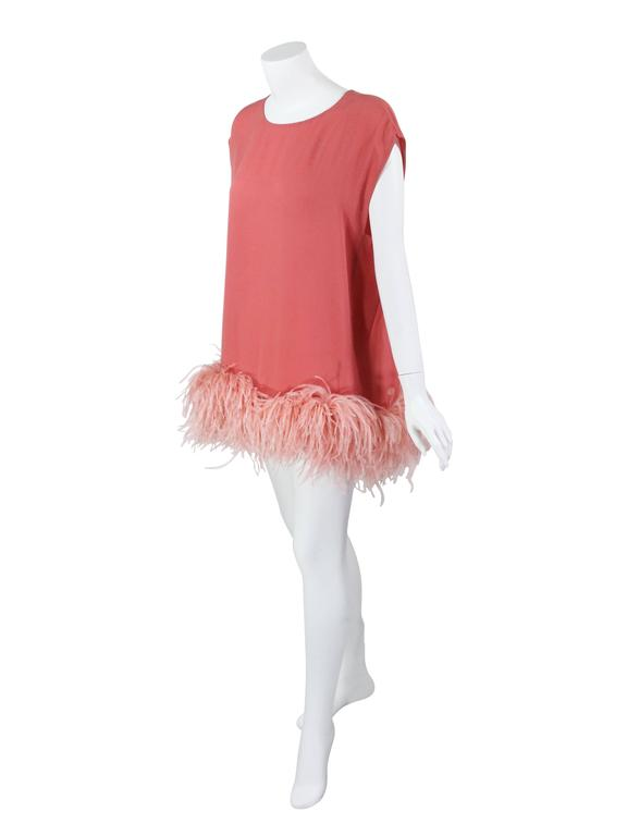 A fantastic Dries Van Noten  ostrich feather trim tunic top from the F/W 2013 collection.  Featuring a bateau neckline and ostrich feather trim hem. Wear it as a tunic or mini dress.  Unlined and slips over the head with no closures. in excellent