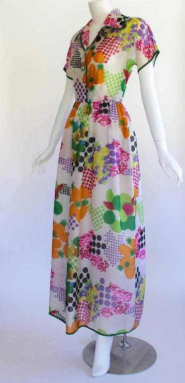 Pop Art meets pretty in this vintage Nina Ricci Boutique dress. Cut from an absolutely delicious print of Ben-Day dots, graphic fruits and romantic flowers in a riot of sumptuous hues, it references all the best of Roy Lichtenstein, Marimekko and
