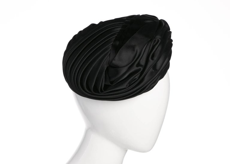 Turban style hats have been incorporated into western fashion since British aesthetes began questioning restrictive dress during the 19th century. During the mid-20th century, everyone from Queen Elizabeth to Audrey Hepburn wore variations on this