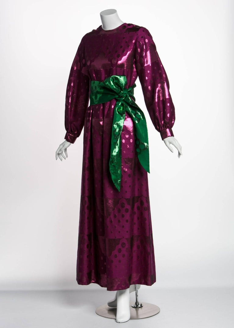 Oscar de la Renta spent a lifetime manipulating luscious fabrics into lavish evening dresses. Frequently seen on the red carpet, de la Renta dresses run the gamut from staid to experimental.  This high gloss dress from the 1960s sparkles like