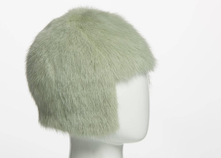 Karl Lagerfeld has practically designed for Chanel longer than Chanel designed for Chanel. Always reverential to Coco's sophistication and style, this fur hat evokes the clipped shape of the 1920s-era bob, which was vogue when Chanel opened her
