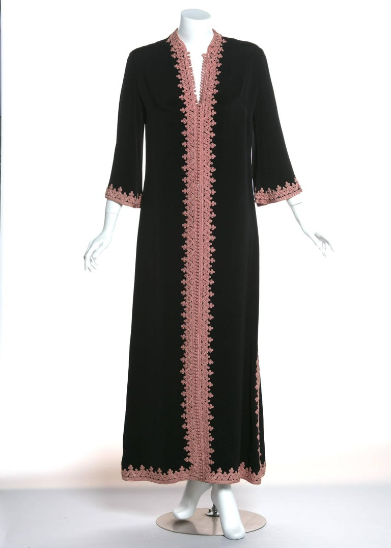 This luxurious caftan was made in Morocco during the1970s, but is origins date back thousands of years and span the globe. The history of the caftan is a bit uncertain. It is believed to have originated from Turkish culture but appears in many