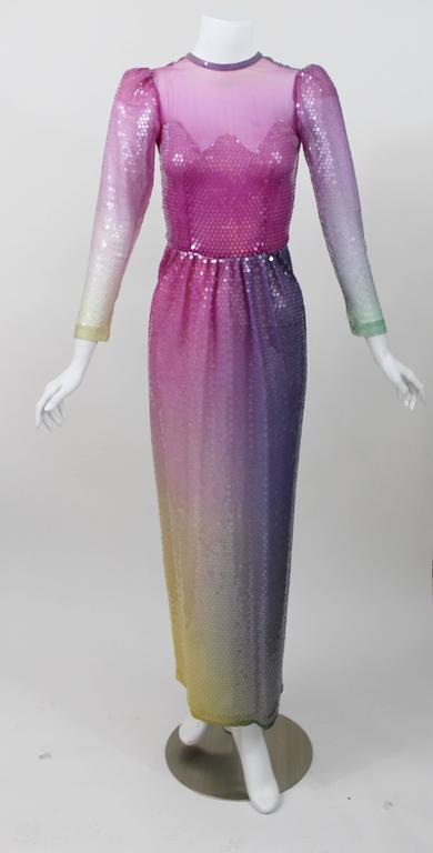 This is a custom couture  gown made for my client in the 1980s.  A magnificent  confection of an evening gown. A  romantic deep hombre pastel sunset of color, offset with a sheer overlay of glistening clear sequins. An Illusion feminine bodice