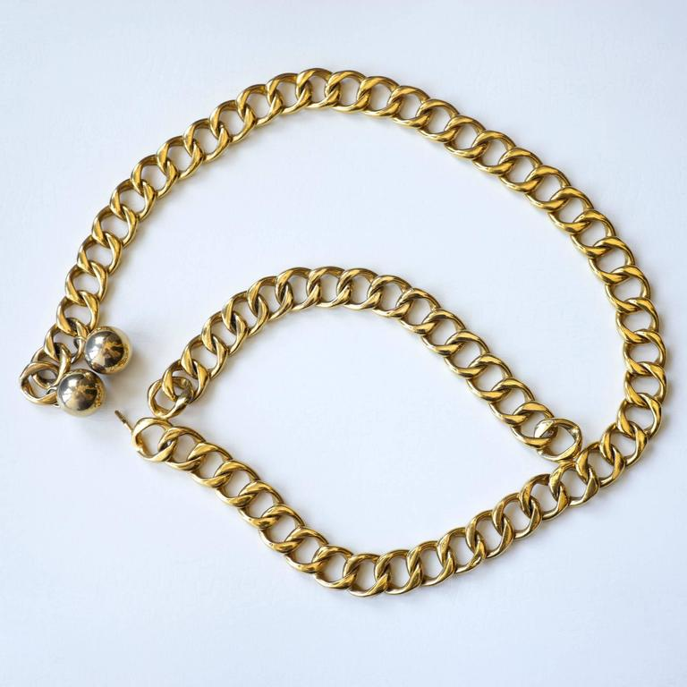 "Chanel classic double chain belt with goldtone chain and two spheres on the end.    -Measurements- length: 31.5"" Thickness: 3/4""  Good Vintage Condition:Please remember all clothes are previously owned and gently worn unless otherwise"