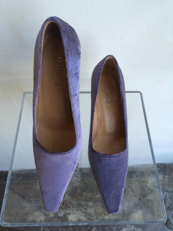 Gucci Lavender Velvet pointed toe Pumps with square tips.  Heel Height: 3 inches Size Marked:  7B  New never used Condition: Please remember all clothes are previously owned and gently worn unless otherwise noted.