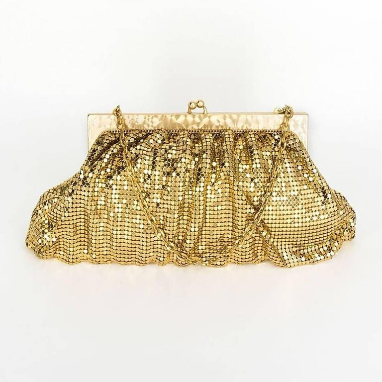 Whiting and Davis art deco era gold mesh handbag with top clasp closure and gold chain handle.  Messurements: Length: 9 1/2 inches  Height: 5 inches  Height w/ chain : 10 inches  Good Vintage Condition: Please remember all clothes are previously