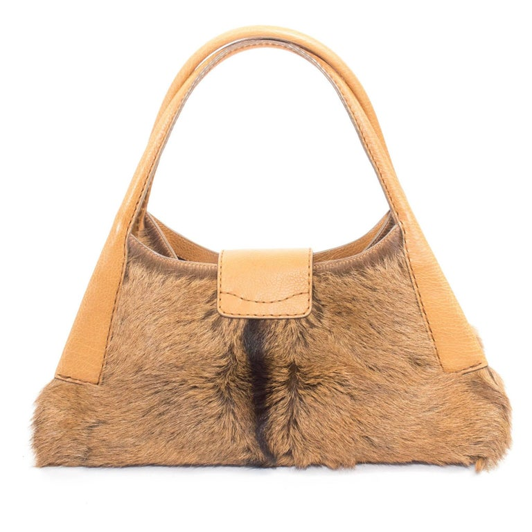 "Tod's Goat Fur Hobo bag with silver-tone hardware and brown wooden lining.  messurments: 8"" Tall X 16"" Wide X 7"" Deep with Handle 14.5"" Tall  Good Vintage Condition: Please remember all clothes are previously owned and gently"