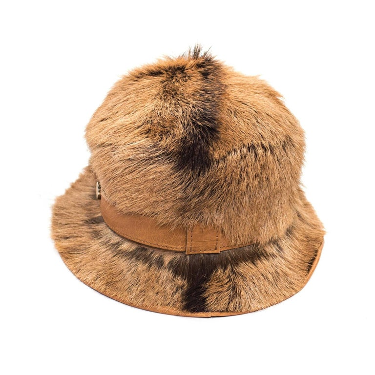 "Tod's Goat Fur Bucket Hat with brown leather band and orange Lining.  Size Large fit: 7.5"" diameter  Good Vintage Condition: Please remember all clothes are previously owned and gently worn unless otherwise noted."