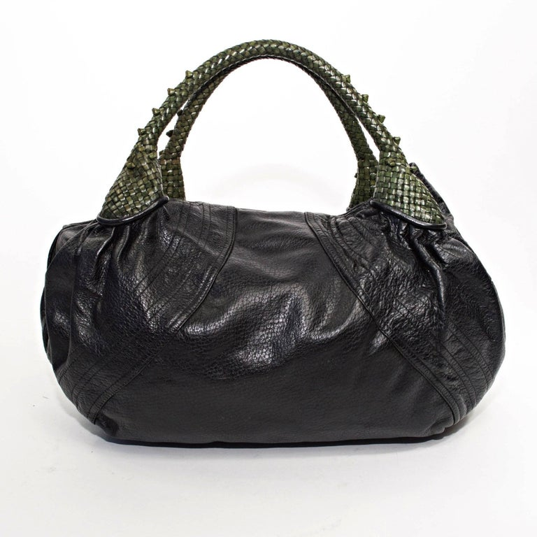 Fendi Spy Bag with Black Nappa Leather and Green Woven Handles with built in Coin Purse.   Measurements 8