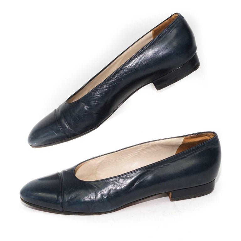 Chanel classic black leather flats with cap toes.  Size Marked:  37 1/2  Good Vintage Condition: Please remember all clothes are previously owned and gently worn unless otherwise noted.
