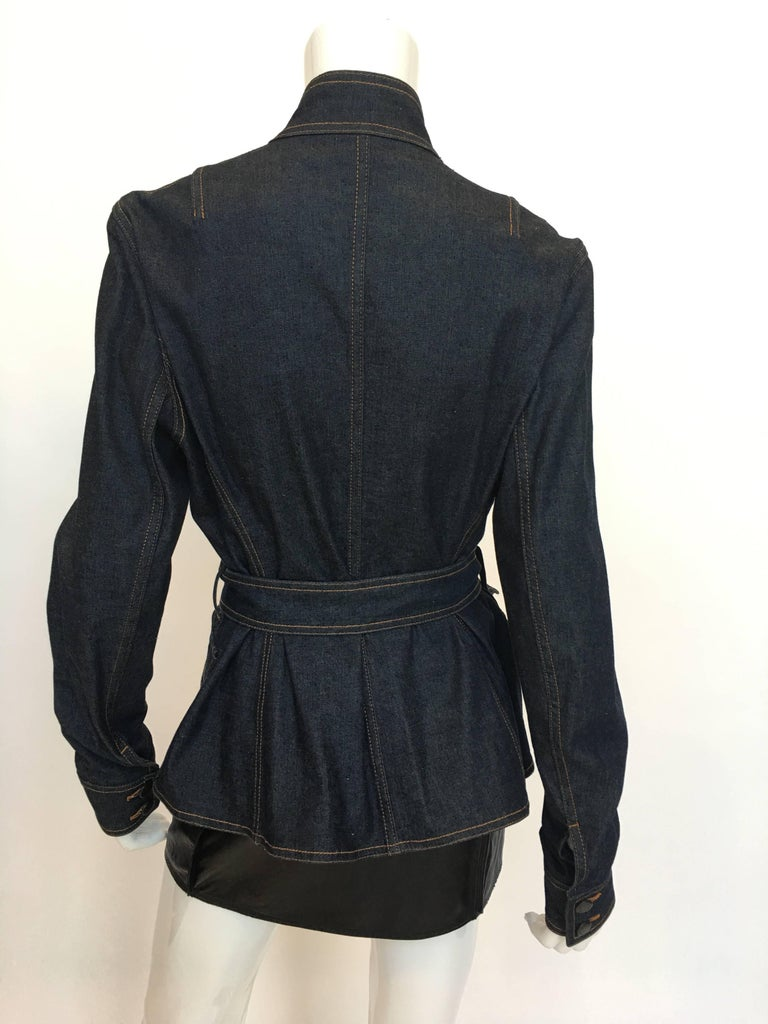 Yves Saint Laurent Rive Gauche 1990'S Denim Jacket. Double breasted with mandarin collar, 2 front patch pockets and belted. 98% cotton , 2% spandex  *ALL MEASUREMENTS TAKEN FLAT*  Shoulder to shoulder: 17