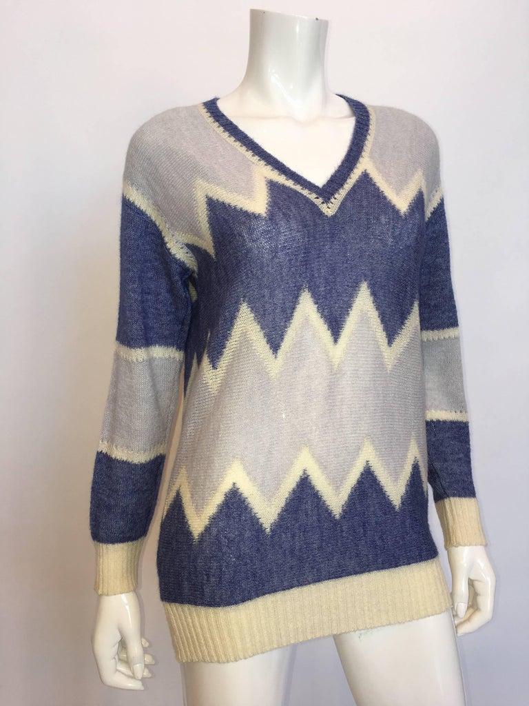 Courrèges Paris 1970's Mohair Sweater  *ALL MEASUREMENTS TAKEN FLAT*  Shoulder to shoulder: 18
