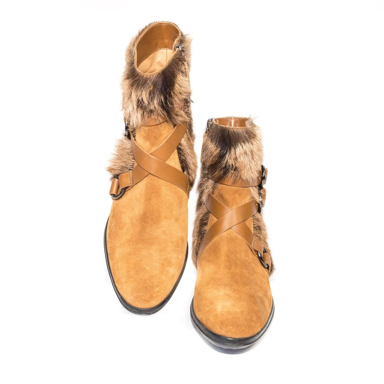 Tod's tan suede and goat Fur boots with a criss cross buckle straps and side zipper.  Size Marked: 37.5   Good Vintage Condition: Please remember all clothes are previously owned and gently worn unless otherwise noted.