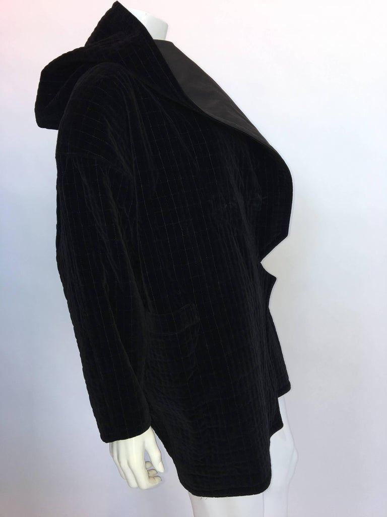 "1980s Versace Blace Quilted Cotton Velvet Hooded Jacket  Made in Italy Size Label N/A  All measurements taken flat: Shoulders - Seam to seam: 24"" Sleeve - Shoulder seam to wrist cuff: 18"" Armpit to armpit: 26"" Bust: 26"" Waist:"