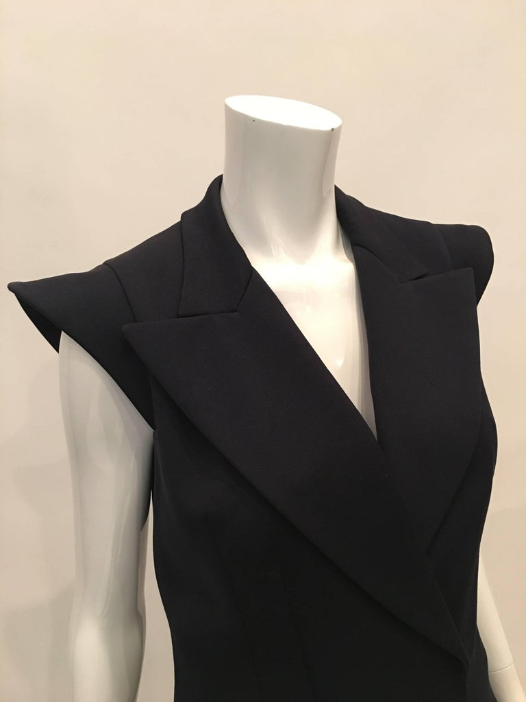 Yves Saint Laurent Wool Midnight Blue Double Breasted Vest with 2 front pockets.  Size Label : 38 (French)  *ALL MEASUREMENTS TAKEN FLAT*  Mannequin measures size 4 , vest fits mannequin  Shoulder to shoulder - 13 inches Armpit to armpit - 17
