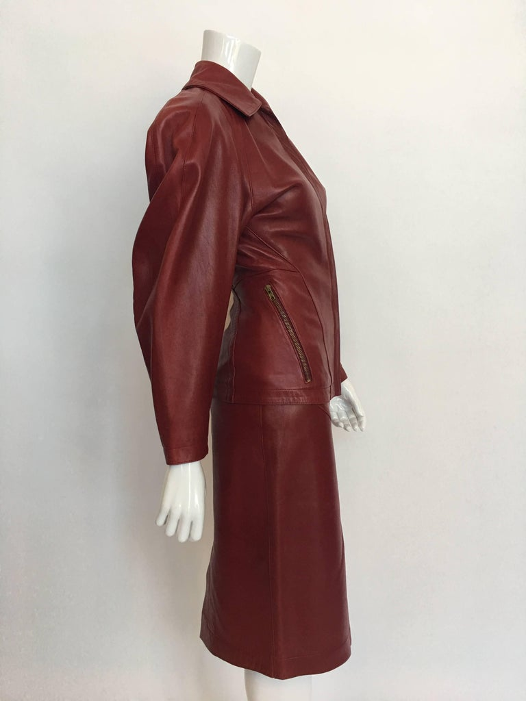 Alaia 1980's Red Leather Skirt Suit with 2 front zip pockets and back inverted pleating. Skirt has a size zip and snap closure with a back vent. Skirt is also fully lined and contains belt loops.  *ALL MEASUREMENTS TAKEN FLAT*  Jacket Label Size: