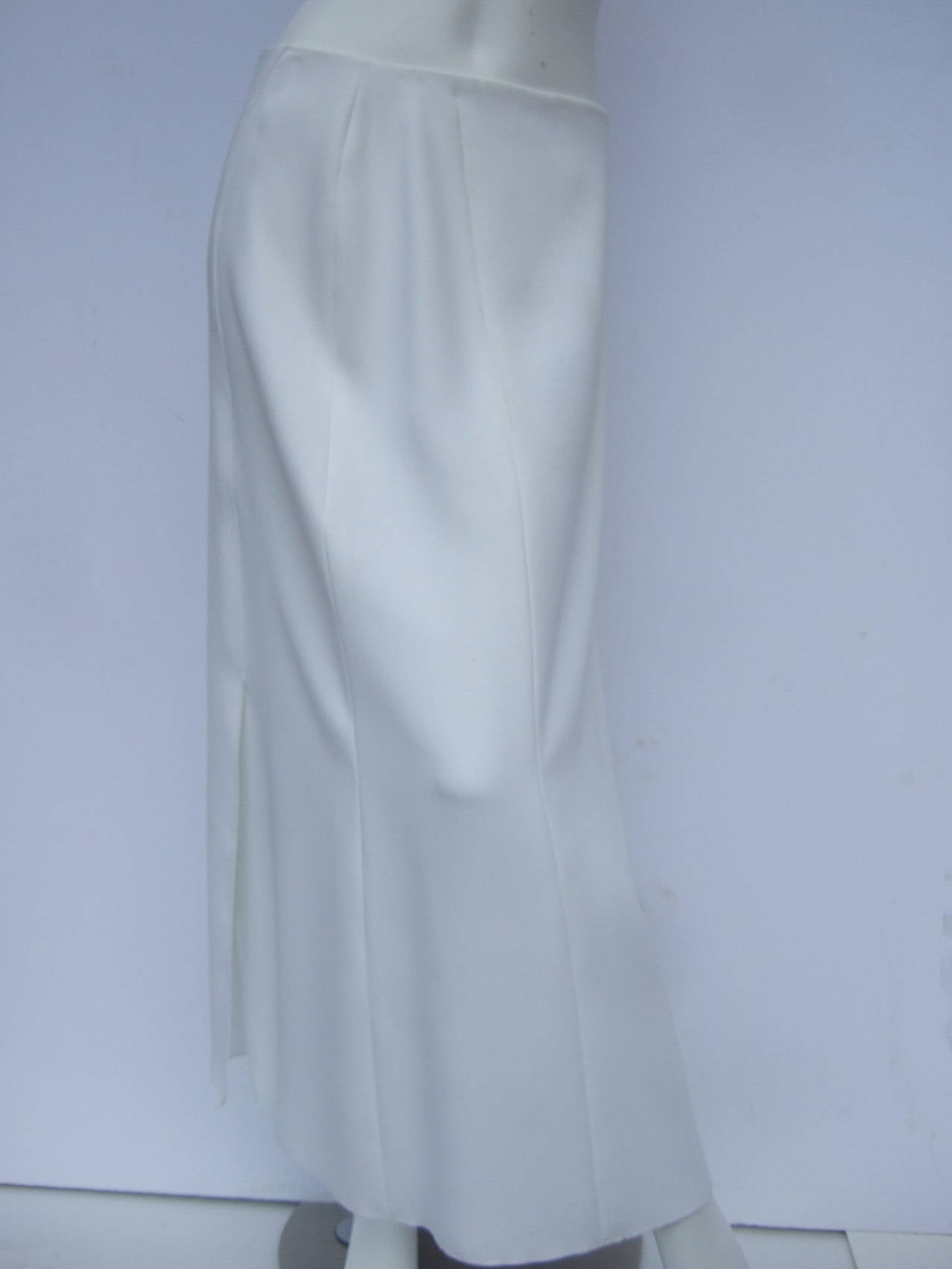 Chanel elegant chic long white skirt Size 40 The crisp high fashion skirt is designed with two dramatic slits One is on the front off center to the side. The other slit is on the back side off center as well  The slit on the front side measures