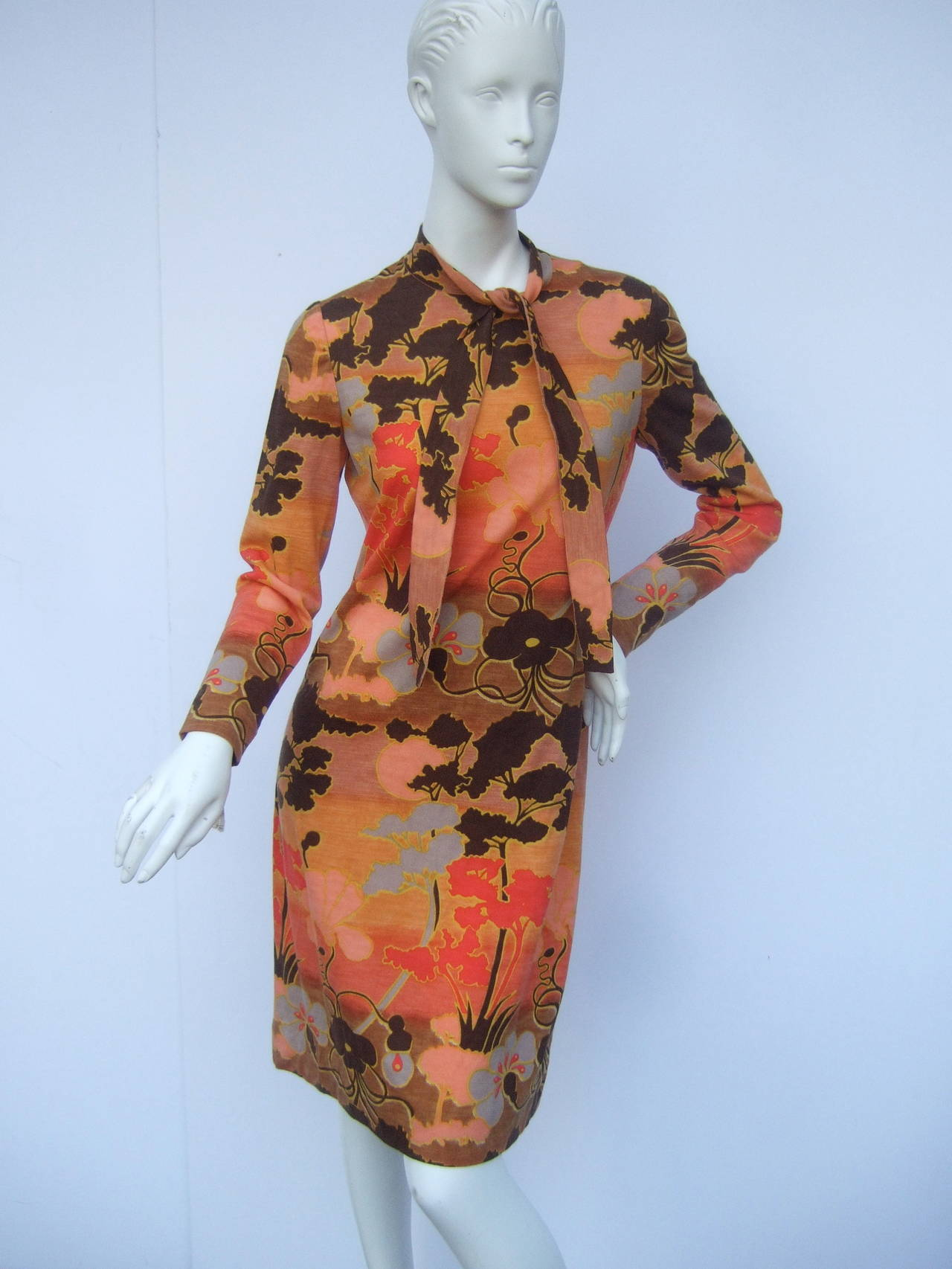 Italian floral print merino wool knit dress designed by Goldworm US Size 8 The vibrant floral print dress is a field of earth tone hues from burnt orange to rich brown colors. The sinuous floral graphics are illustrated throughout the bold merino