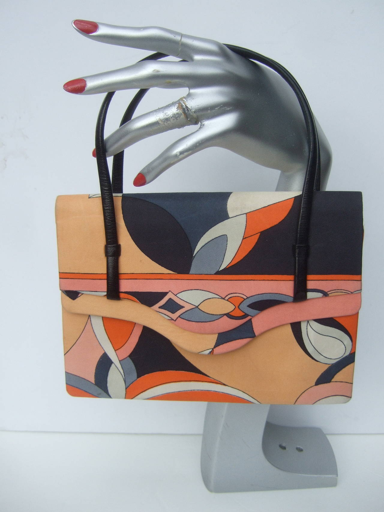 Emilio Pucci Italy Silk diminutive envelope style handbag c 1970 The mod op-art silk print is a collage of color blocked graphics The spectrum of colors range from pale pink, peach, tangerine, silver gray, gunmetal gray, white & black    The
