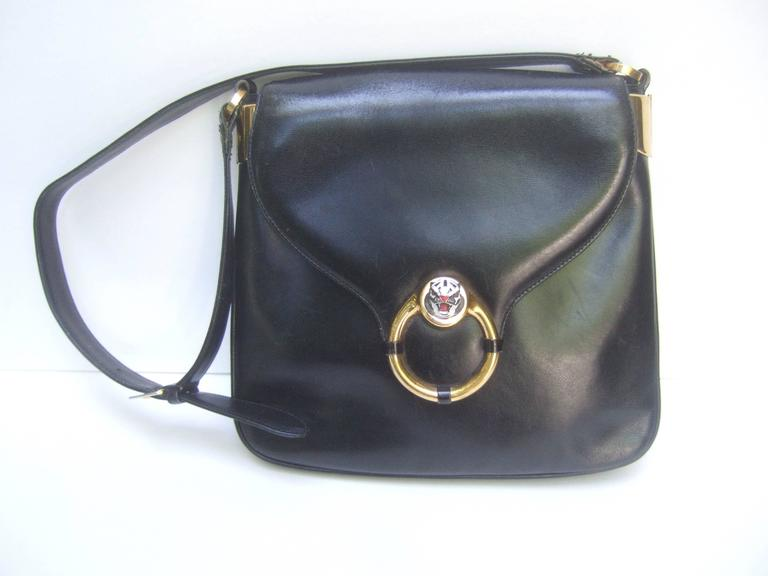 783778a91bed Gucci Rare ebony leather tiger emblem shoulder bag c 1970s The Italian  designer handbag is adorned