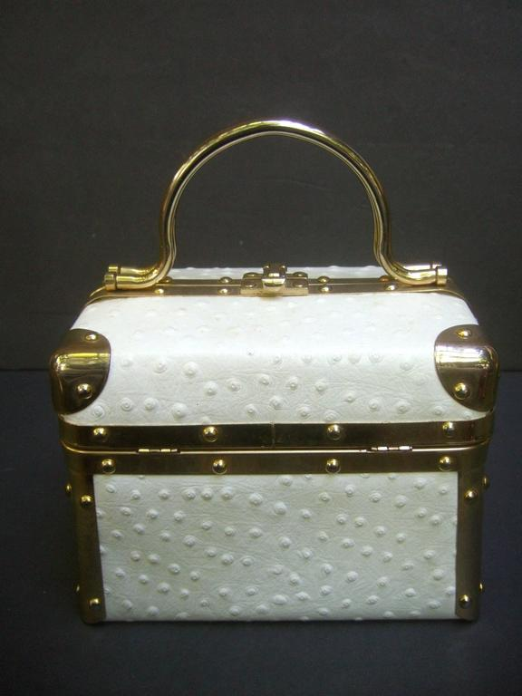 Borsa Bella Italian white ostrich leather box purse c 1980s The posh Italian handbag is covered with exotic white ostrich leather on all sides   Designed with sleek gilt metal hardware trim with metal swivel handles. The interior is lined in brown