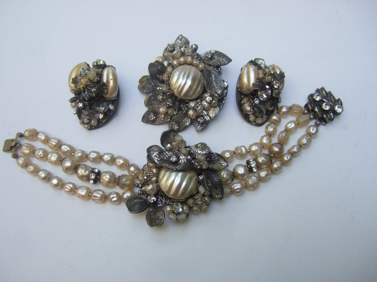 1950s Costume pearl brooch, bracelet & earrings by Robert  The elegant vintage set is designed with a larger glass enamel  pearl embellished with tiny enamel seed pearls & diamante  prong set crystals. The embellished are wired to pewter