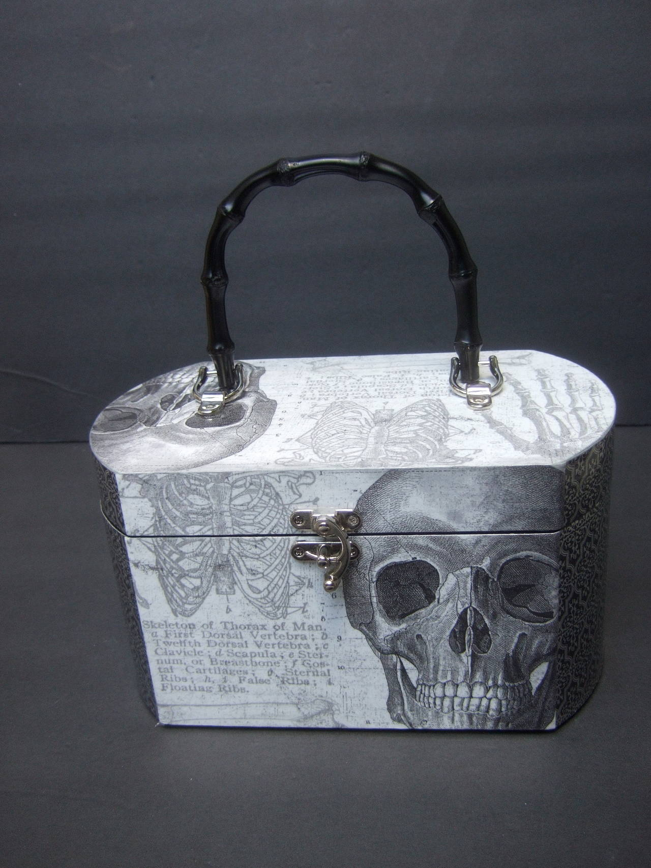 Avant-garde decoupage skeleton box style handbag