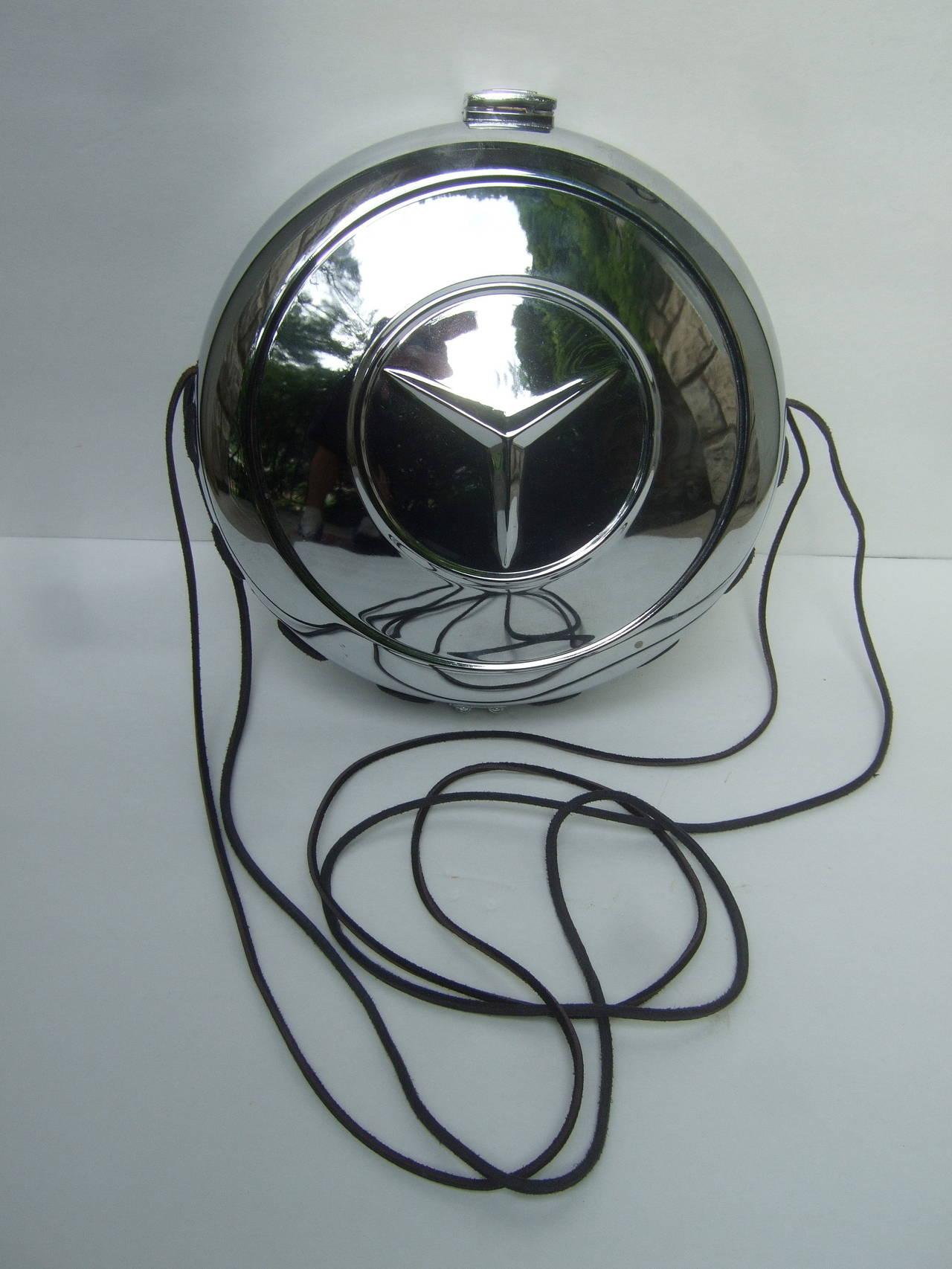 Avant garde industrial mercedes benz hub cap handbag c for Mercedes benz hats sale