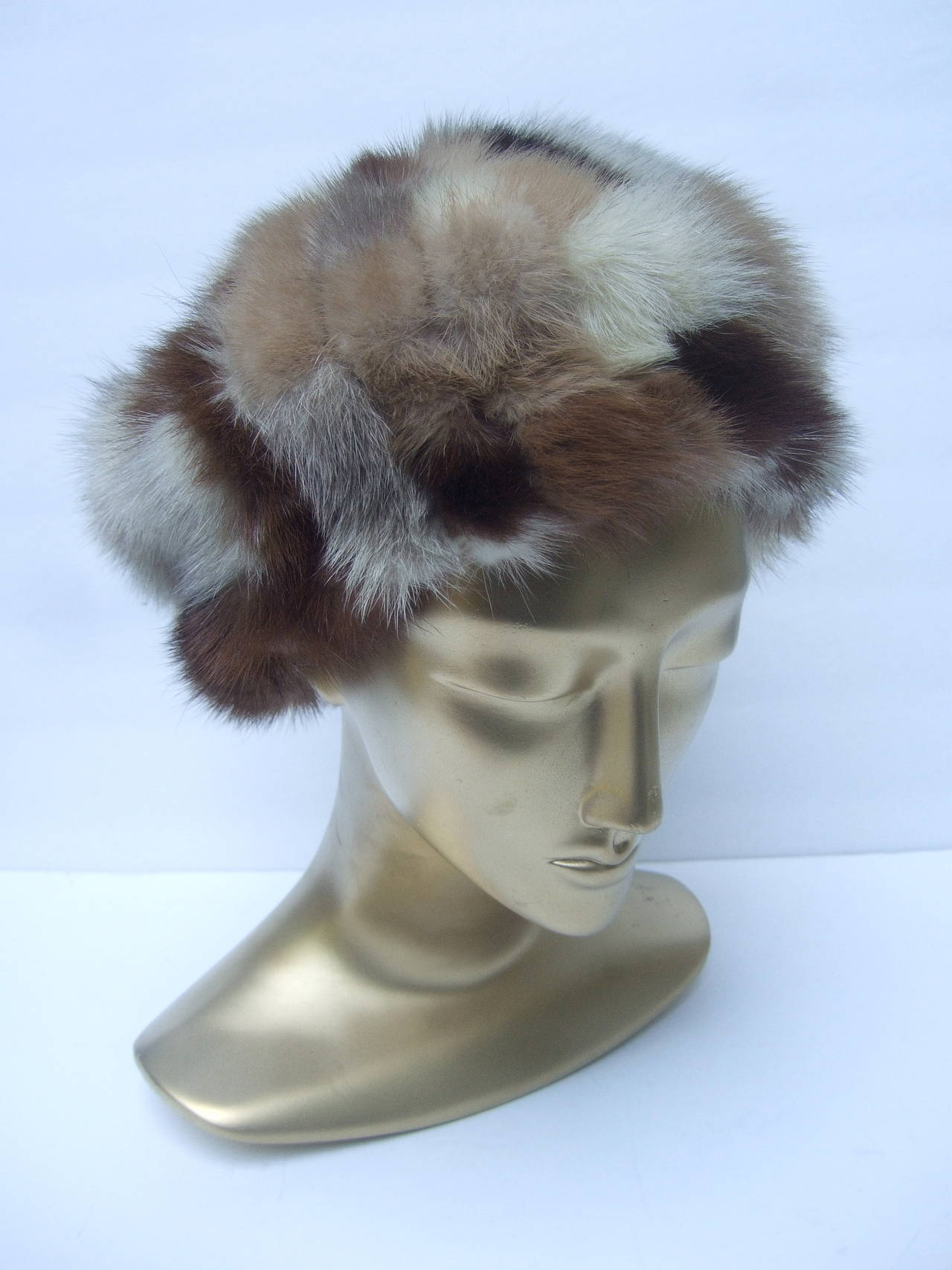 Saks Fifth Avenue Patch tile hat c 1970 The stylish retro mink fur hat is designed  with a myriad of different colors of mink  The mink patch tiles range from blonde, to medium brown to darker mahogany   The interior is lined in brown