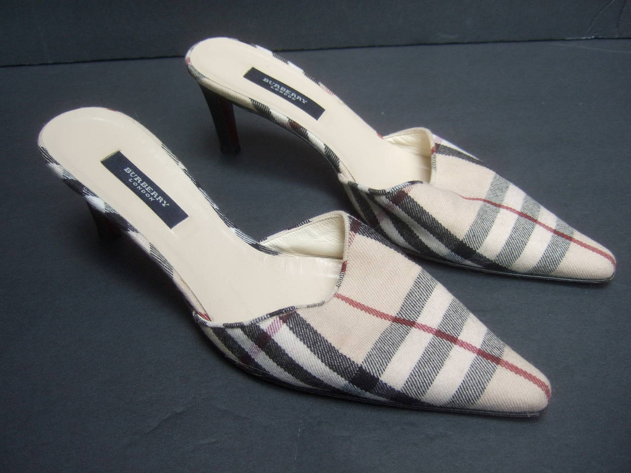 Burberry London classic nova plaid wool mules Size 37.5 The stylish designer shoes are covered with Burberry's  signature wool nova plaid   The interior of the shoes are lined in tan leather Labeled Burberry London Made in Italy  Size 37 1/2
